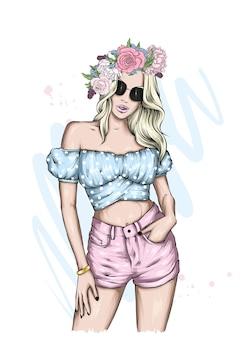 세련 된 여름 옷을 입고 아름 다운 소녀
