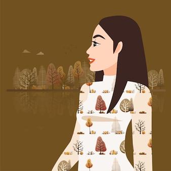 Красивая девушка в осеннем платье, стоя на фоне осеннего парка