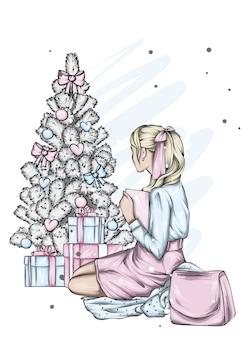 크리스마스 트리 근처 아름 다운 소녀입니다.
