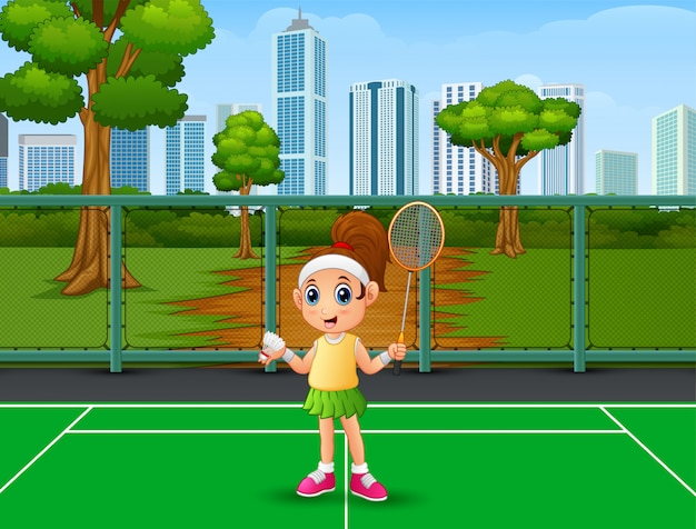 Beautiful girl playing badminton at the court