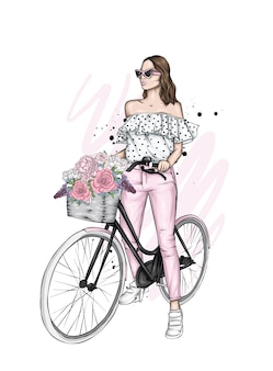 Beautiful girl in stylish clothes on a bicycle.
