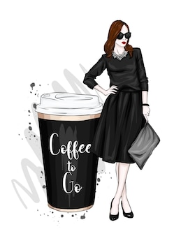 Beautiful girl in stylish clothes and a large glass of coffee
