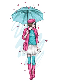 Beautiful girl in stylish clothes and with an umbrella