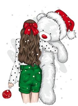 おもちゃのクマと美しい少女。クリスマス。