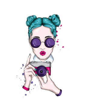 Beautiful girl with glasses and vintage camera