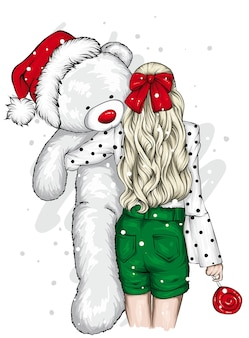 Beautiful girl with a toy bear. christmas.