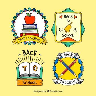 学校に戻っての美しい手描きバッジ