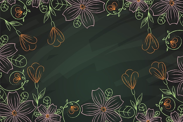 Beautiful hand drawn flowers on blackboard background