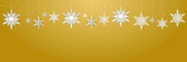 크리스마스, 새해, 겨울 배너, 인사말 카드에 대한 골드 배경 정장에 아름다운 매달려 눈송이와 떨어지는 눈 프리미엄 벡터