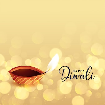 Beautiful happy diwali bokeh background with diya