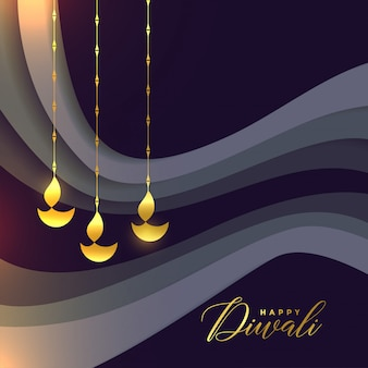 Beautiful happy diwali greeting with golden diya