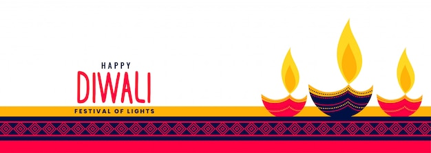 Beautiful happy diwali long banner with decorative three diya lamps