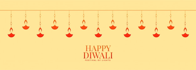 Beautiful happy diwali wide banner with diya decoration