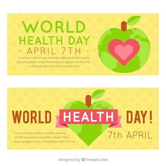 Belle bandiere giornata mondiale della salute con la mela e il cuore