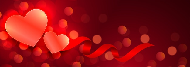 Beautiful hearts glowing red bokeh banner