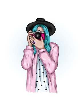Beautiful hipster girl in a hat and with a camera