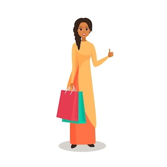 Beautiful indian woman is shopping. the girl with the packages gesturing with fingers and showing up. isolated from white Premium Vector