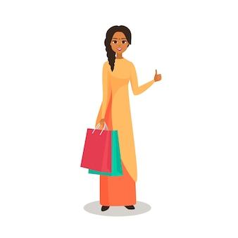 아름 다운 인도 여자 쇼핑입니다. 패키지가 손가락으로 몸짓으로 나타나고있는 소녀. 흰색에서 격리