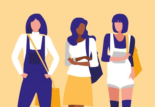 Beautiful interracial girls group modeling with handbag