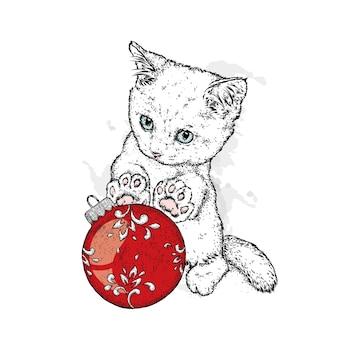 美しい子猫とクリスマスボール。