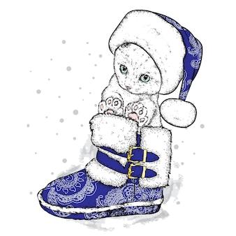 クリスマスの服と新年の美しい子猫