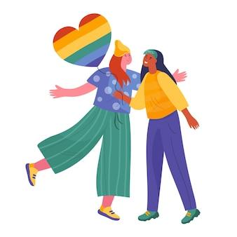 Bella coppia lesbica con bandiera lgbt