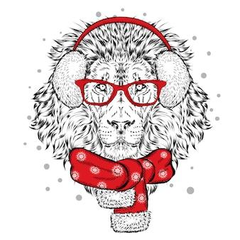 冬のスカーフとヘッドフォンで美しいライオン。正月とクリスマス。