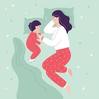 아름다운 엄마와 딸이 침대에서 자
