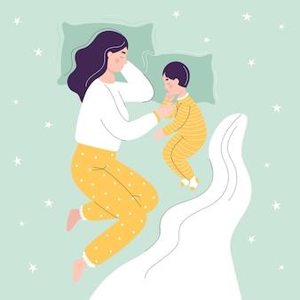아름다운 엄마와 아들이 침대에서 자고있다.