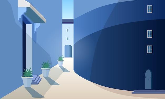 建物、伝統的な形のドア、鉢植えの屋外植物のある美しいモロッコの街並み