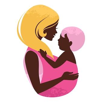 Красивый силуэт матери с ребенком в слинге