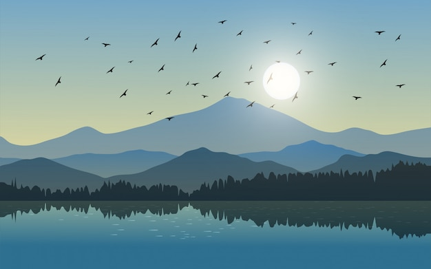 Beautiful mountain landscape with lake and birds