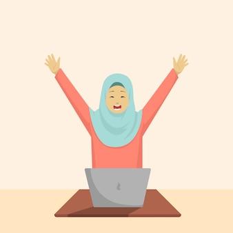彼女の手を上げている間コンピューターを遊んで美しいイスラム教徒の女性