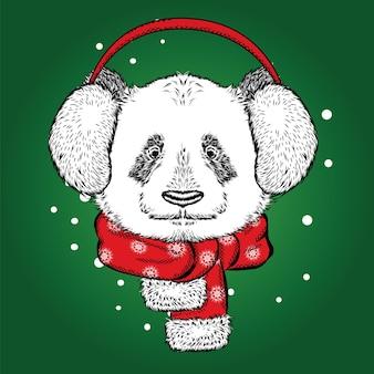 冬のヘッドフォンで美しいパンダ。クリスマス。