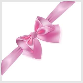 실크로 만든 리본이있는 아름다운 분홍색 활, 대각선으로 위치