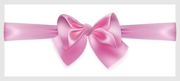 Beautiful pink bow with ribbon made of silk, located horizontally