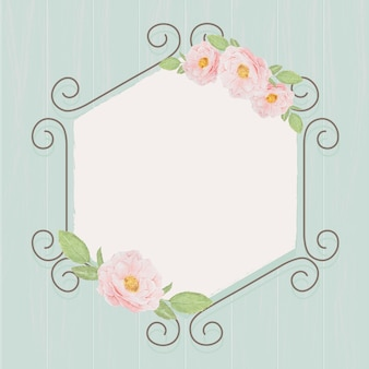 블루 그런 지 나무 질감 배경에 육각형 아이비 아치 화 환 프레임에 아름 다운 핑크 영어 장미