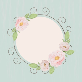 Beautiful pink english roses wreath frame on blue grunge wood textured background