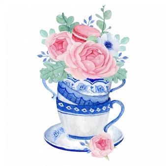 ティーカップの美しいピンクの花の花束、花とマカロンのティータイム
