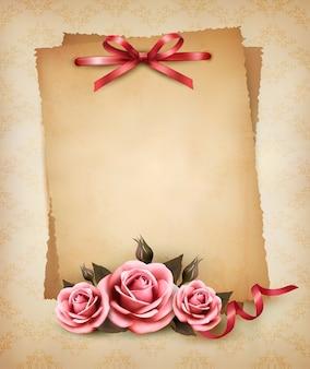 아름다운 분홍색 장미와 오래된 종이