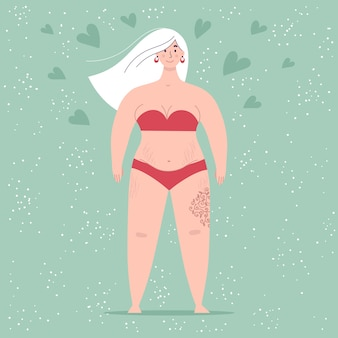 A beautiful plump woman in a swimsuit stands in full growth