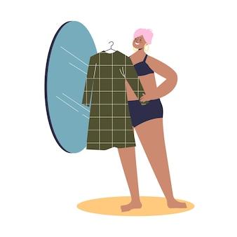 거울 앞에서 새 드레스를 시도하는 아름다운 플러스 사이즈 여자 모델. 모델링 및 패션 산업에서 일하는 귀여운 매력적인 여성 만화 캐릭터 프리미엄 벡터