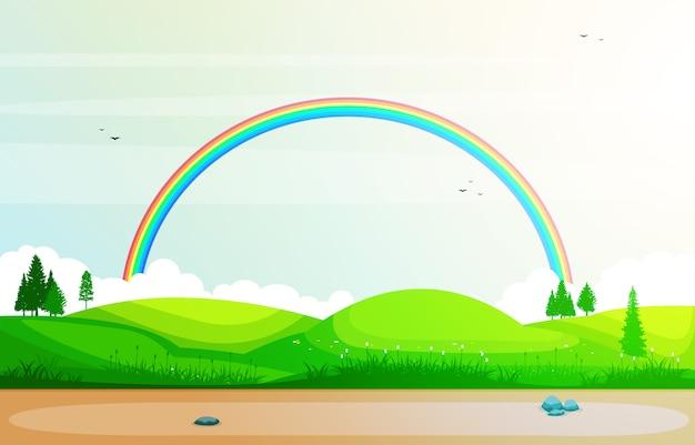 Beautiful rainbow sky with green meadow mountain nature