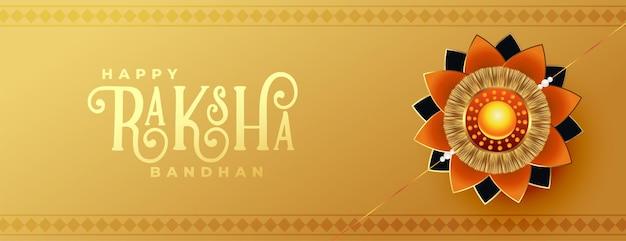 Beautiful raksha bandhan golden banner with realistic rakhi