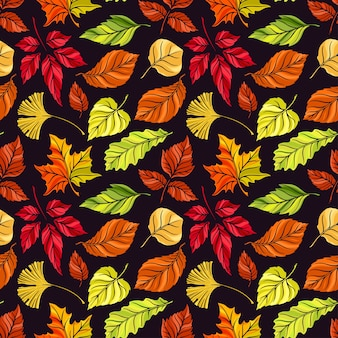 Beautiful seamless background of different autumn leaves on a dark background. hand-drawn illustration
