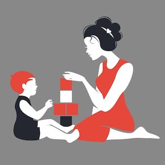 엄마와 아기가 장난감을 가지고 노는 아름다운 실루엣. 해피 어머니의 날