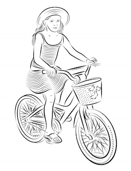 Beautiful small girl riding a children bike.
