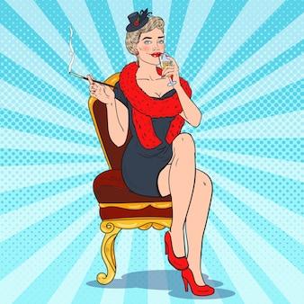 シャンパングラスで美しい喫煙女性