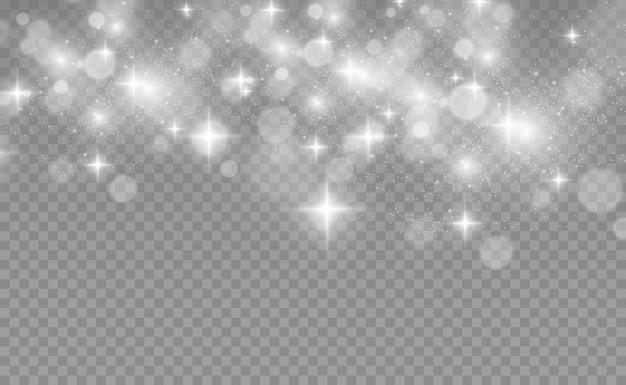 Особенным светом сияют красивые искры. блестит на прозрачном фоне. аннотация . прекрасная иллюстрация к открытке. фон для изображения.
