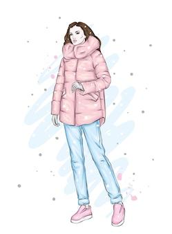 スタイリッシュなコートとズボンを着た美しく背の高い細身の女の子。かかとの高い靴を履いたスタイリッシュな女性。